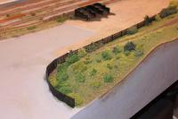 Fencing complete and path installed on embankment in front of goods yard.  [156.JPG uploaded 7 Feb 2014]