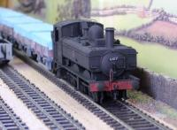 A care-worn pannier tank with China clay wagons  [SAM_0393.JPG uploaded 7 Jan 2016]