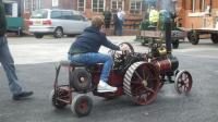 Callam, one of our younger members takes the traction engine for a spin past the Listers   [DSCF0046a.JPG uploaded 20 Oct 2015]